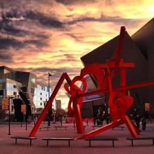 Mark di Suvero's statue, Lao-Tzu, which stands on Acoma Plaza ouside the Denver Art Museum in Colorado. Lao-Tzu gets its name for the Chinese philosopher-poet who founded Taoism in the sixth-century B.C. Like the Taoist yin-yang, Lao-Tzu suggests a union of opposites, of forms and voids.